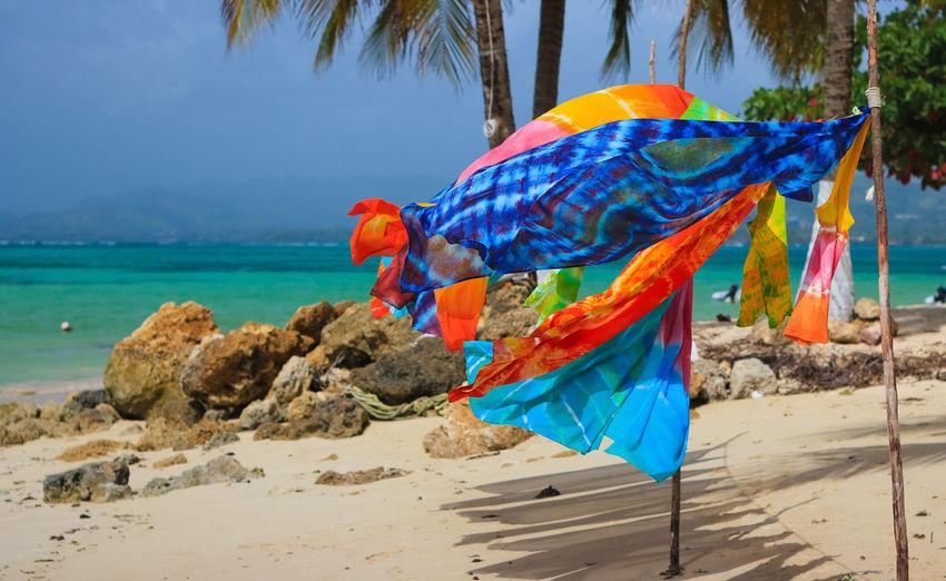 Close-Up Of Multi Colored Umbrella On Beach
