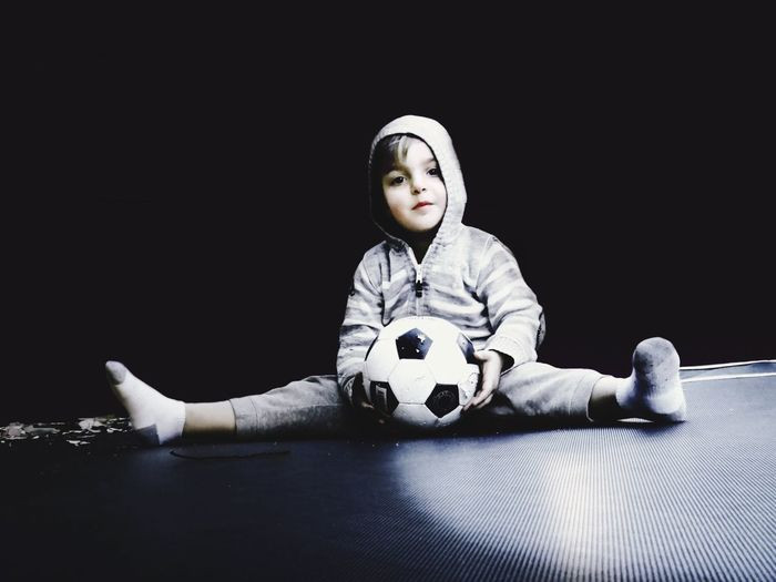 play time Kid Kids Family Boy Portrait Childhood Children Sports Sport Soccer Ball Soccer⚽ Soccer Child Portraits Black Background Mono Background Monotone Background Things I Like Alternative Fitness Telling Stories Differently My Favorite Photo The Portraitist - 2016 EyeEm Awards Football Fever Football Natural Light Portrait Welcome To Black