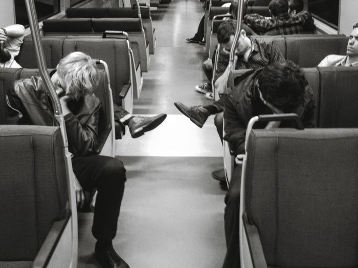 Tired people napping in train