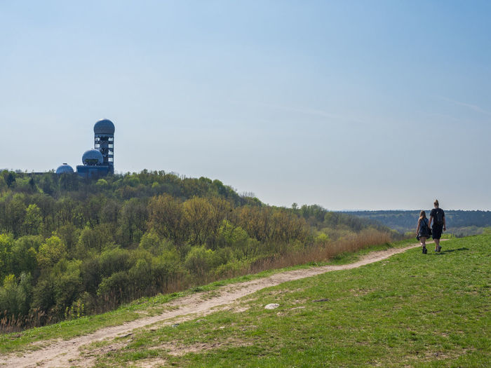 Berlin Couple Copy Space Day Environment Field Full Length Grass Land Landscape Leisure Activity Men Nature Non-urban Scene Outdoor Outdoors People Plant Rear View Scenics - Nature Sky Teufelsberg Tree Two People Walking