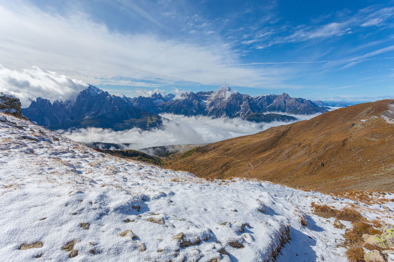 Panorama of pustertal valley covered by clouds with amazing dolomite peaks background, italy