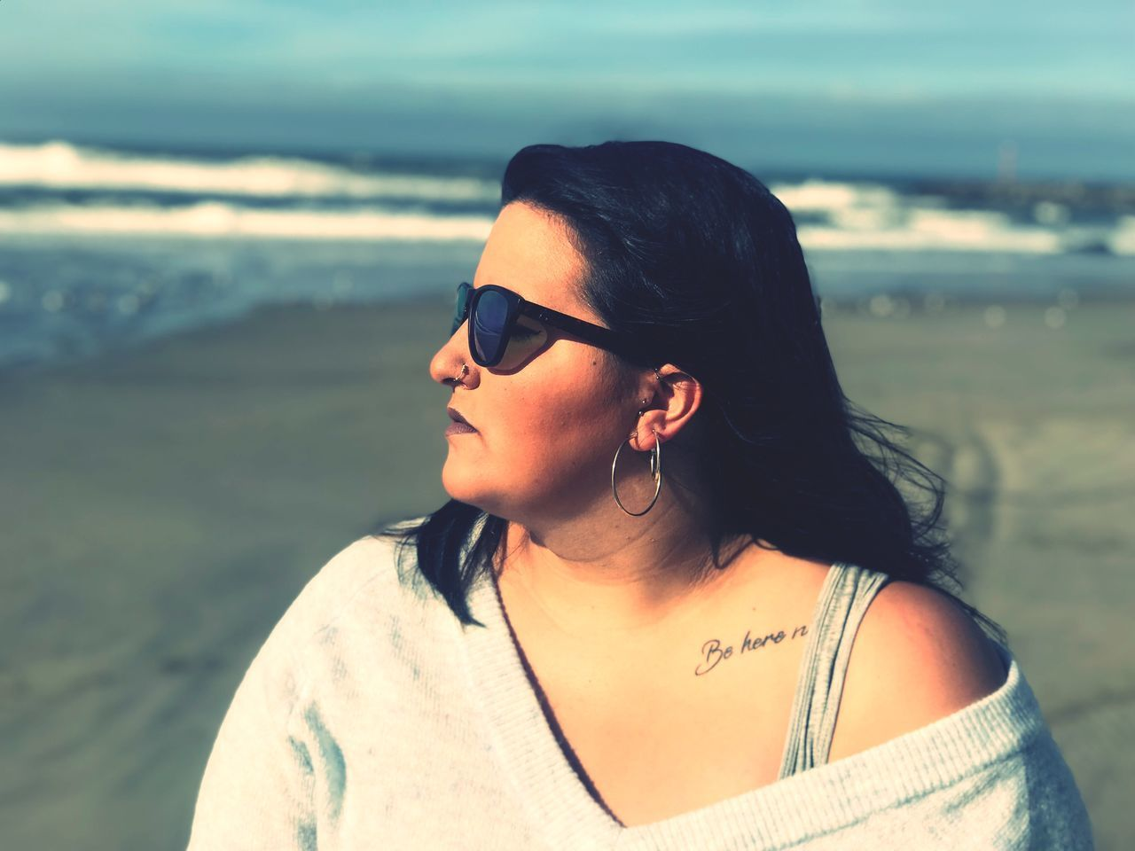 Overweight woman looking away at beach