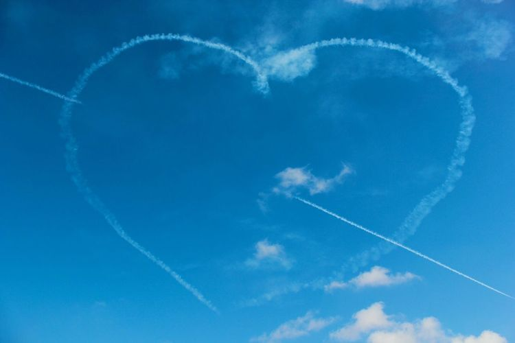 Heart Shaped Vapor Trails In Sky