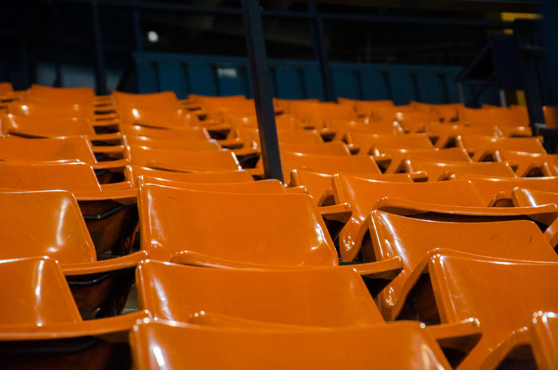 Auditorium Close-up Day Group Of Objects Hockey In A Row Indoors  Large Group Of Objects No People Orange Orange Color Orange Seats Pastel Repetition Row Seat Seats Stadium Warm Colors