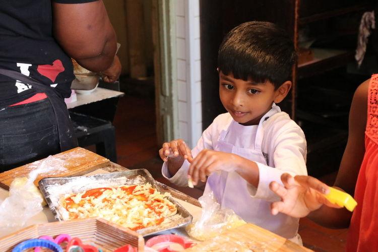 Siblings Preparing Sweet Pie In Kitchen