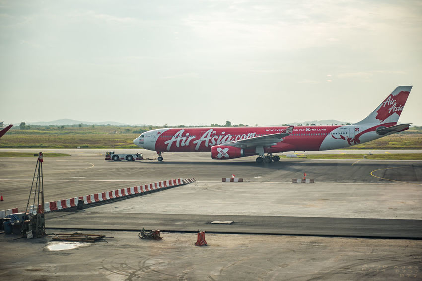 Air Asia at KLIA 2 Air Asia Air Vehicle Airplane Airport Runway Day No People Outdoors Sky Transportation