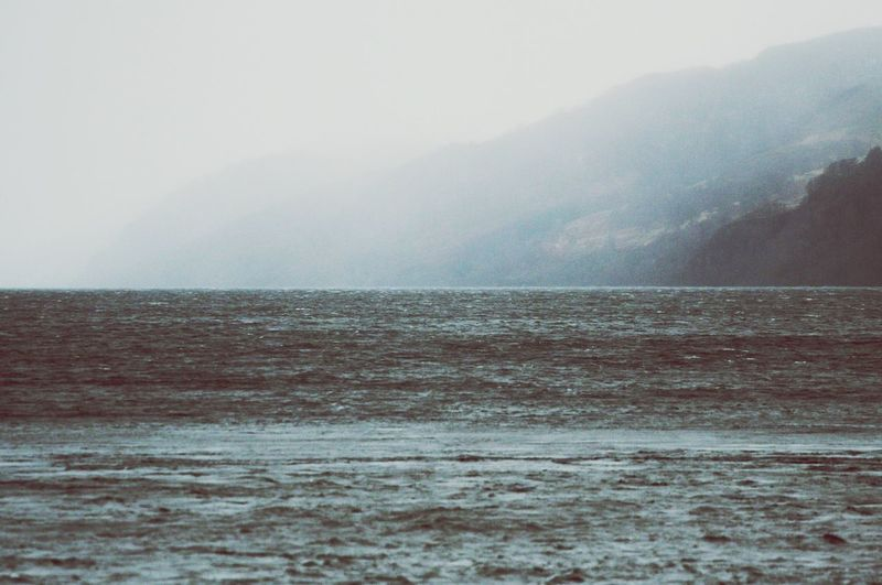 View of Loch Ness with hills disappearing in mist Loch Ness Lake Scotland Vanishing Hill Mountan Cloud Mist View Sight Beautyfil Mystical Water Surface Wilderness