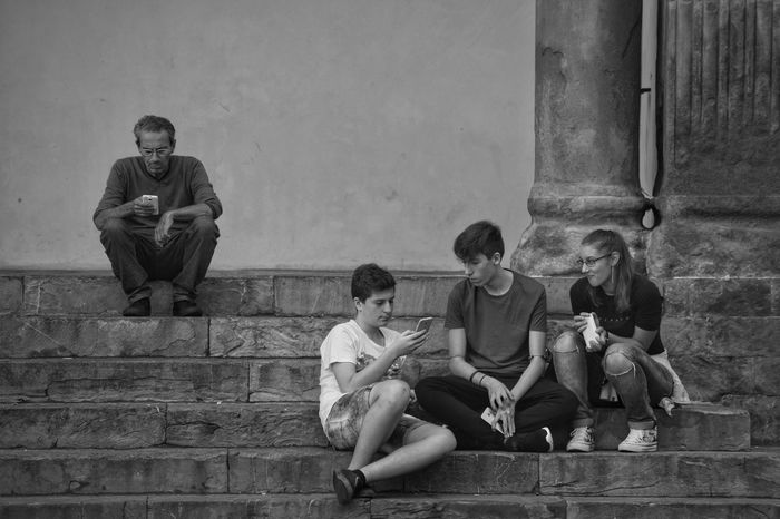 People Full Length Togetherness Friendship Outdoors Young Adult City Sitting Young And Old Crouching Street Photography People Watching Monochrome Black And White Lifestyles Shadows & Lights Florence Real People Built Structure Shapes And Forms Italy Relaxing Visit Italy Life Is Art The Week On EyeEm