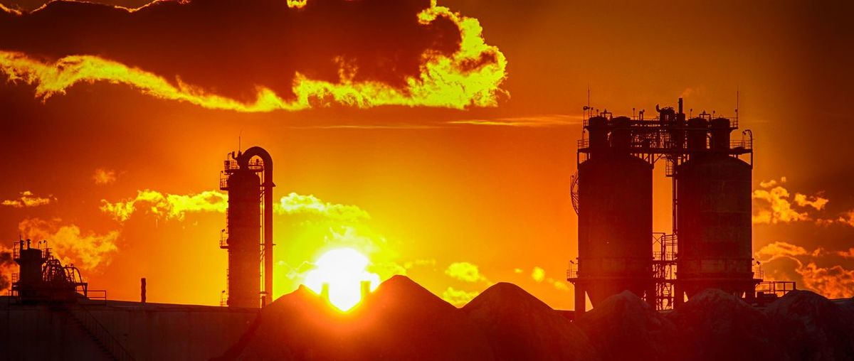 Oil Refinery Against Cloudy Sky During Sunset