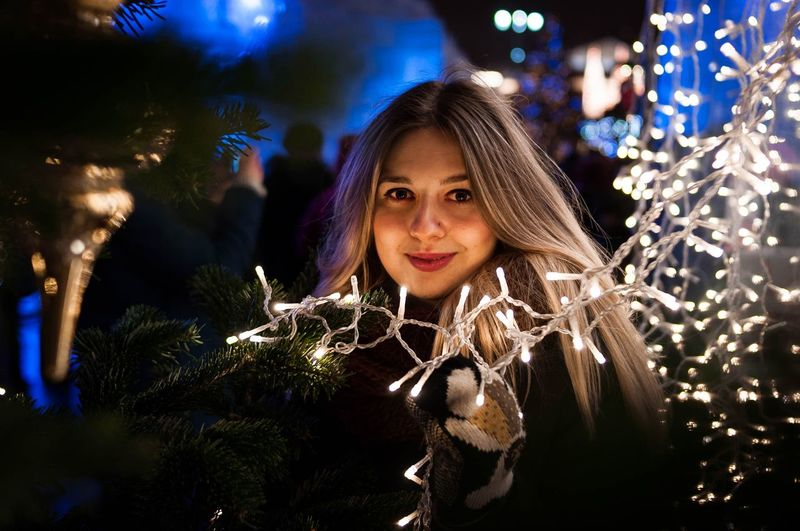 Night Portrait Looking At Camera Smiling Beauty Christmas One Person Nightlife Christmas Decoration Dark Illuminated Beautiful Woman Christmas Tree Russian Tradition Russia Fair New Year Fair New Year's Eve New Year Around The World Outdoors Arts Culture And Entertainment Beautiful People Warm Clothing