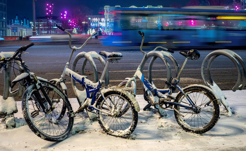 Bicycles parked on road at night