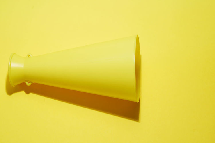 Close-up of yellow pencils against white background