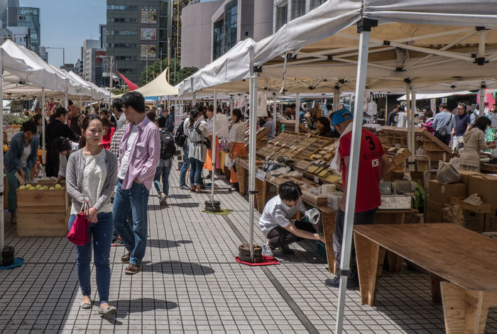 Weekly held local farmer's market at United Nations University, Tokyo, Japan Buyer Cheap City Crowd Farmers Farmers Market Goods Japan Local Local Market Market Marketplace People People Person Produce Product Purchase Retail  Selling Shopper Shopping Stall STAND