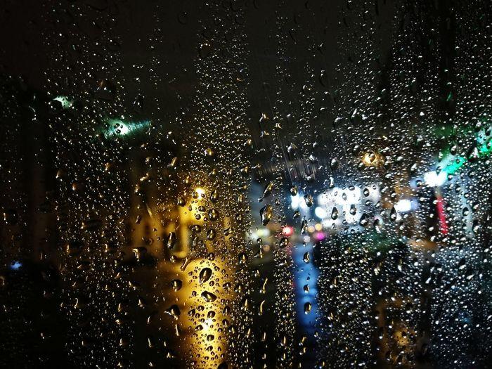 Katowice City at Night Rain Water Drop Window Weather Illuminated Night RainDrop Backgrounds Focus On Foreground No People Rainy City Life Transparent Season  Wet Katowice Lights Car Photo Poland Silesia Fall Bedweather First Eyeem Photo