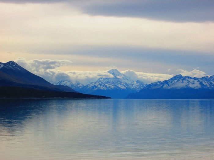 Snow capped mountains surrounded by clouds Peak Mount Cook National Park Aoraki Mt Cook, New Zealand Ice Reflection Clouds South Island New Zealand Mount Cook Mount Cook Aoraki Water Mountain Snow Cold Temperature Winter Lake Snowcapped Mountain Glacier Wilderness Area Frozen Winter Nature Outdoors Mountain Range Waterfront Idyllic