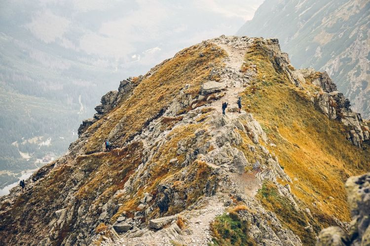 Aerial View Of Hikers On Mountain Against Sky