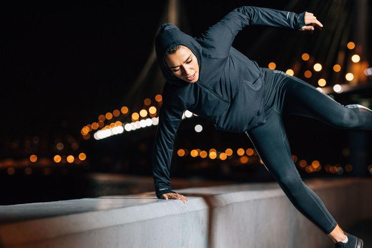Full length of young man dancing at night