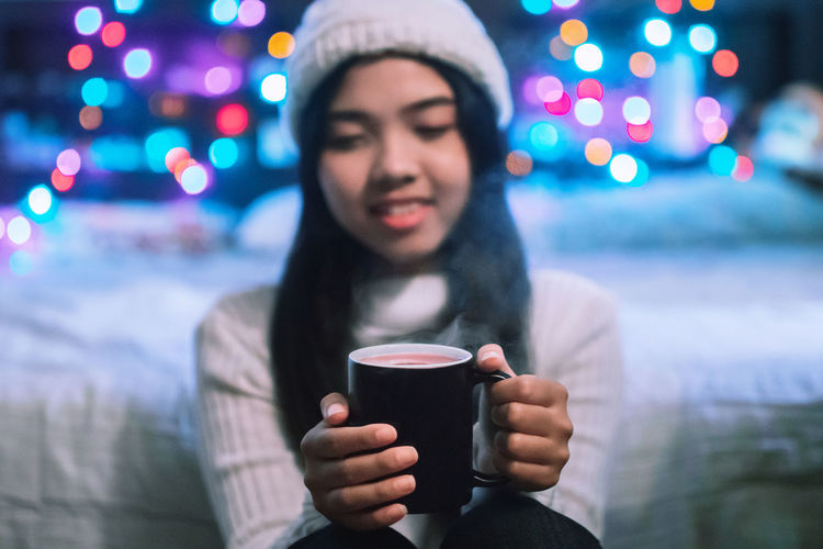 Coffee a hug in a mug .The glass in the hands of woman. Bokeh color rianbow. Coffee in the winter. Celebration Christmas Coffee Coffee Shop Coffee And Cigarettes Coffee Time Coffee ☕ Happiness Light Winter Bokeh Bokeh Photography Coffee Coffee - Drink Coffee Break Coffee Cup Cup Drink Drinking Food And Drink Lifestyles Light And Shadow Refreshment Winter Young Women