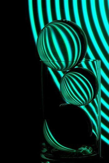 Glass Ball Sphere Longexposure Lightpaintingphotography Lightpainting Art Abstract Pattern No People Indoors  Close-up Still Life Green Color Illuminated Glass - Material Lighting Equipment Spiral Black Background Hanging Geometric Shape Glowing Nature Night Design Studio Shot Multi Colored