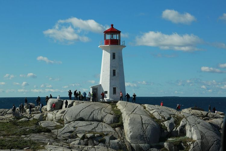 Lighthouse of Peggy's Cove Sky Sea Lighthouse Cloud - Sky Day Large Group Of People Water Outdoors