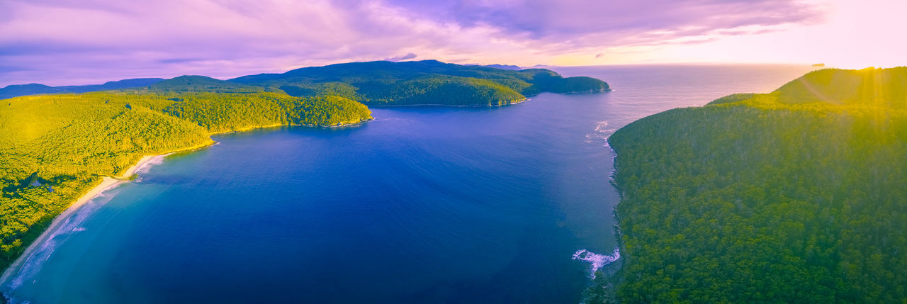 Aerial panorama of Fortescue Bay at sunset. Tasman National Park, Victoria, Australia Australia Australian Landscape Bay Beautiful Nature Beauty In Nature Day Fortescue Bay Landscape Large Format Nature No People Outdoors Panorama Panoramic Photography Scenics Sea Sky Sunrise Sunset Tasmania Travel Destinations Water