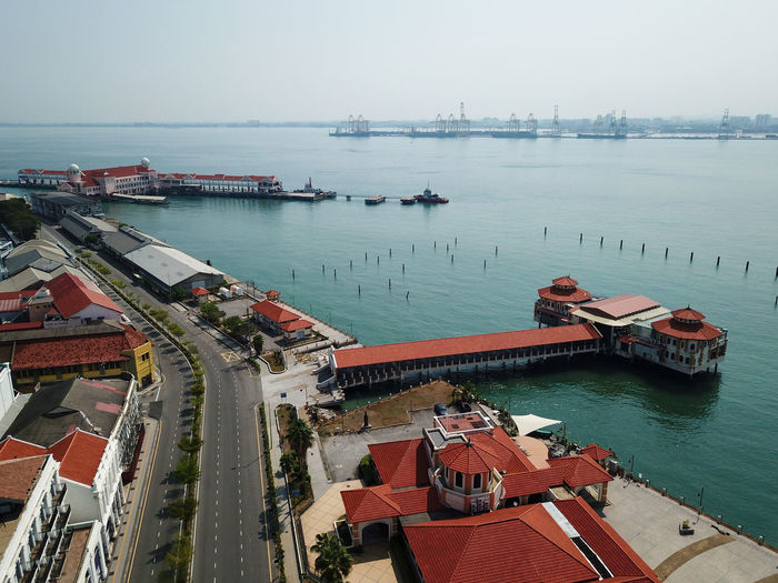 High angle view of harbor by sea against sky
