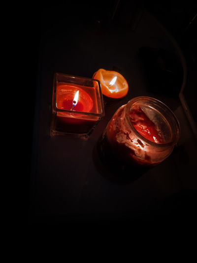 three candles in the dark Mystery Vigil Warmth Heat - Temperature Three Objects Orange Color Red Color Burning Light Darkness Black Background Close-up Darkroom Candlelight Lit Flame Candle Burning Wax Tea Light Glowing Fire Fire - Natural Phenomenon
