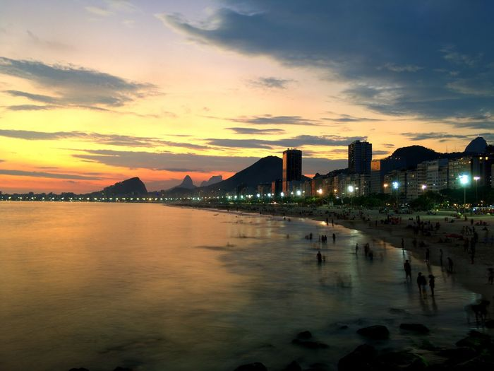 Copacabana Beach Copacabana Rio De Janeiro Rio De Janeiro Eyeem Fotos Collection⛵ Happy New Year Architecture Sky Water Sunset City Cloud - Sky Built Structure Building Exterior Nature Travel Destinations Cityscape Building Sea Beach Illuminated No People Reflection Orange Color Skyscraper Outdoors