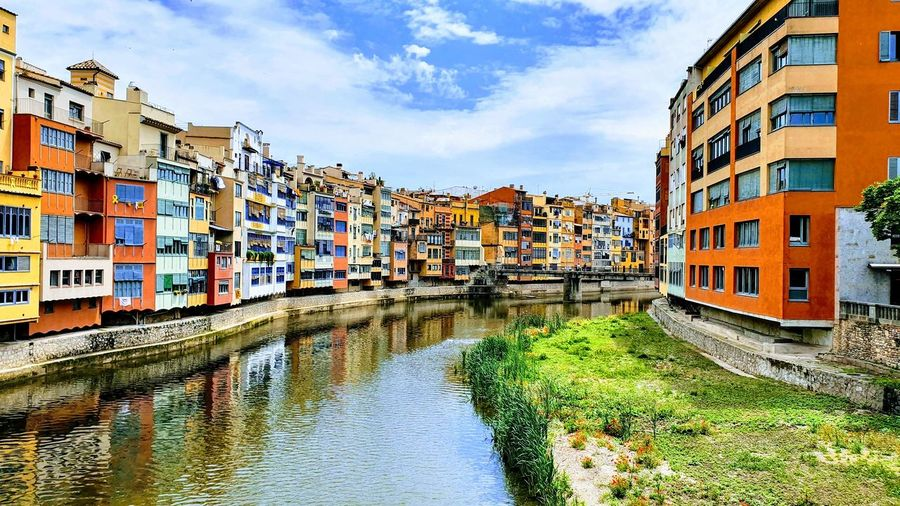 Colours of Catalunya... Apartment Community Residential Building Water Sky Architecture Building Exterior Built Structure Old Town Housing Settlement Housing Development Row House Astronomical Clock Residential District Housing Problems Townhouse Settlement Tiled Roof  Gondola Canal Office Building Residential Structure Human Settlement Gondola - Traditional Boat Detached House TOWNSCAPE Gondolier