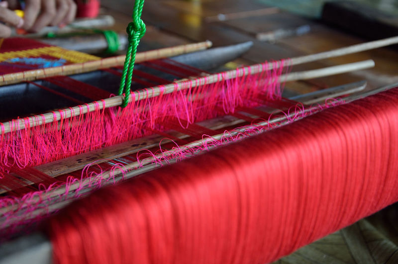 Close-up Day Detail Focus On Foreground Green Color Hand Loom Loom Multi Colored Nature No People Outdoors Part Of Red Selective Focus Textile Textile Art Weaving Work Tool Lombok-Indonesia Lombok Handmade