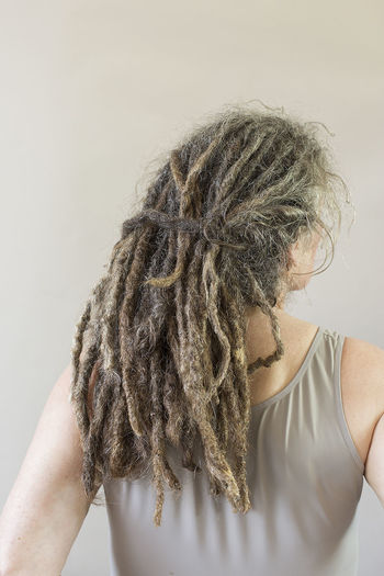Woman in her fifties with grey dreadlocks seen on the back Age Back Backgrounds Beautiful Braids Caucasian Wo Dreadlocks Elderly Exotic Fashion Female Gray Grey Hair Hairstyle Healthy Eating Lifestyles Long Middle Aged Part Of RASTA Rear View Strong Style Woman