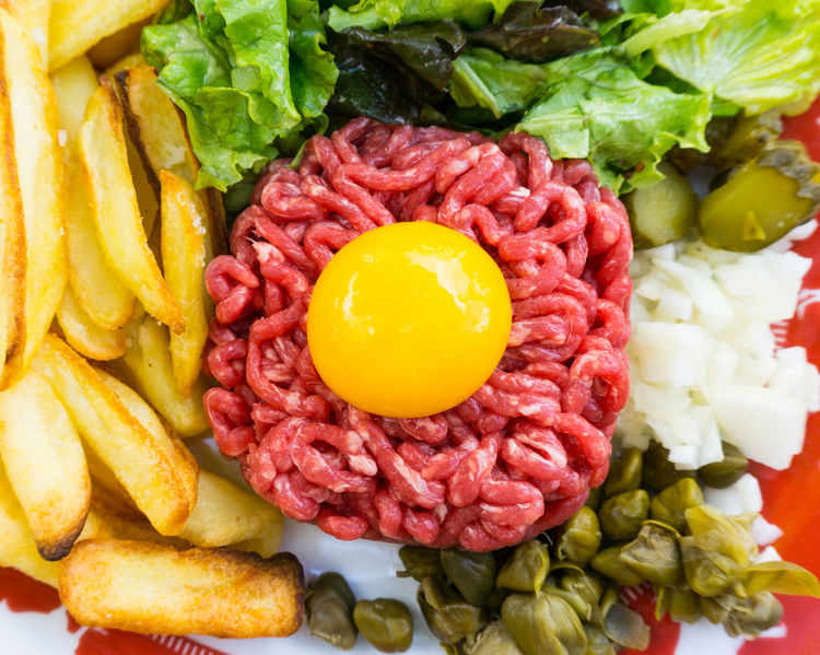 Close-up Day Egg Yolk Food Food And Drink Freshness Fried Egg Ground Beef Healthy Eating High Angle View Indoors  No People Plate Raw Beef Raw Food