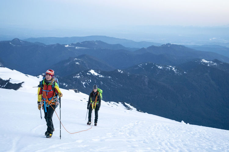 People on snowcapped mountains during winter