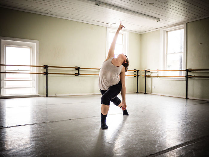 Full Length Of Woman Performing Ballet Dance In Studio