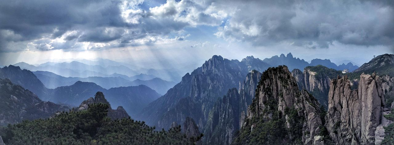 Beauty In Nature Cloud - Sky Cloudy Day Extreme Terrain Geology Majestic Mountain Mountain Range Nature No People Non-urban Scene Outdoors Panoramic Physical Geography Remote Rock Formation Rocky Rocky Mountains Scenics Sky Solitude Tranquil Scene Tranquility Tree