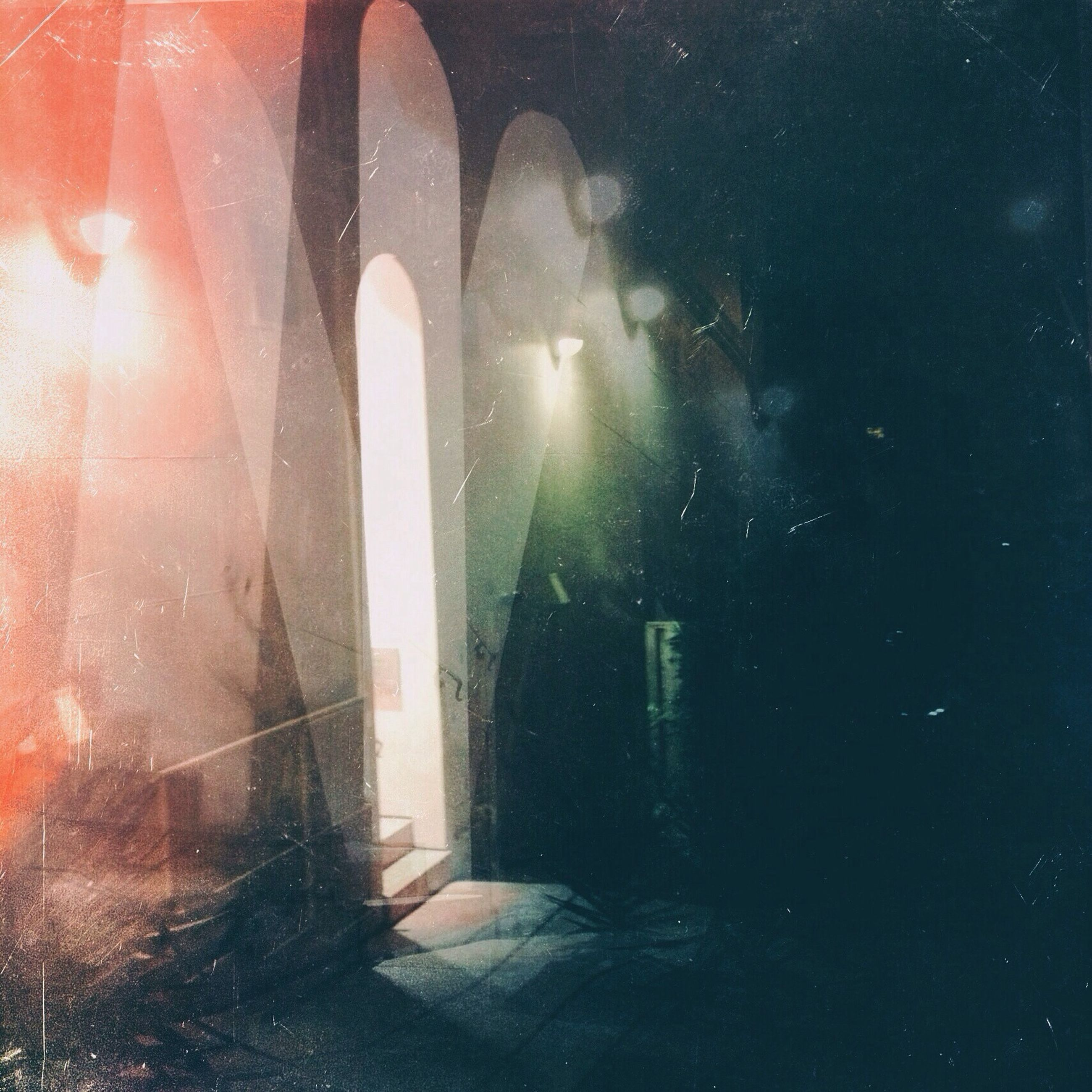 night, illuminated, window, dark, sunlight, indoors, reflection, water, built structure, no people, shadow, silhouette, architecture, building exterior, glass - material, light - natural phenomenon, street, wet, lens flare