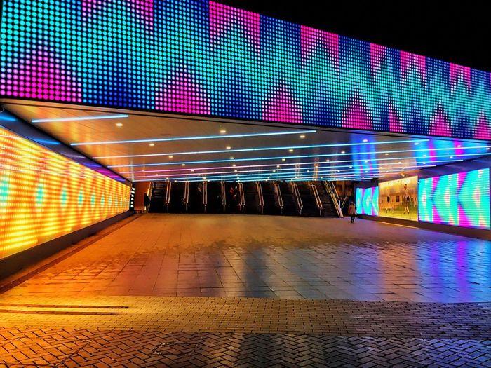 Illuminated subway station at night