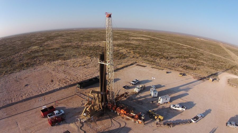 High Angle View Of Drilling Rigs On Oil Field Against Sky