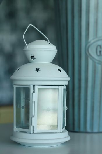 Close-up of lantern on table