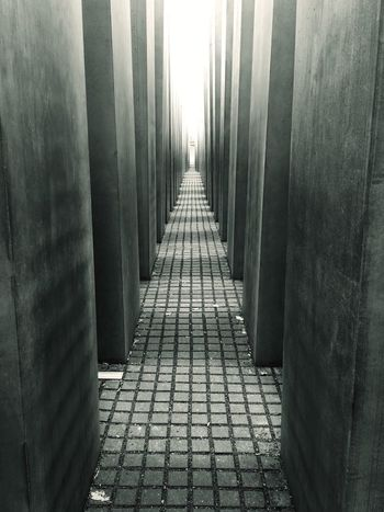 Berlin Holocaust Memorial Holocaust Memorial Berlin EyeEm Best Shots - Black + White Eye4photography  EyeEmBestPics Monochrome Black & White Black And White Blackandwhite Photography Eye4black&white  Black&white Blackandwhite Streetphoto_bw Material Contrast Shillouette Memorial History Stone Showcase March Reflective Thoughtful Corridor Into The Light