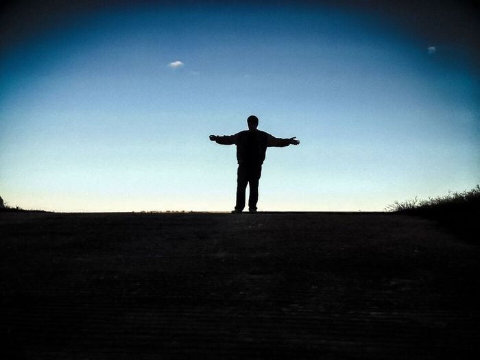 He's got the whole world in his hands. Ontheshoulderofgiants Silhouette Son Riverbank