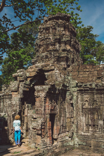 Siem Reap Cambodia Angkor Curly Hair Girl History Built Structure Architecture The Past Place Of Worship Religion Belief Real People Spirituality Building Ancient Day Plant Building Exterior Tree Tourism Nature Travel People Outdoors Ancient Civilization Visit