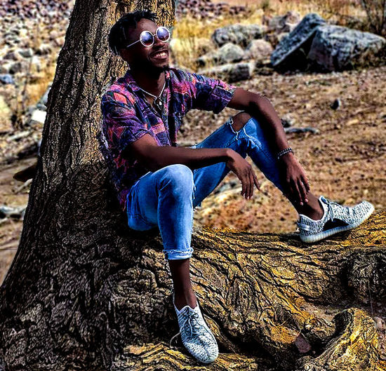 Black Coloado Springs EyeEm Eyeglasses  Faded Fashion Handsome Instagram One Person Outdoors Sitting Style Stylish Tree Trunk VSCO Yezzus Young Adult