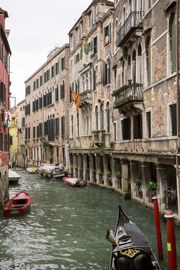 Venetian canal with a variety of boats moored to old Italian buildings with peeling walls. Nautical Vessel Mode Of Transportation Transportation Water Canal Gondola - Traditional Boat Day Architecture Nature Built Structure Waterfront Travel Building Exterior Gondola Outdoors Travel Destinations Wooden Post City Building Incidental People Passenger Craft My Best Photo