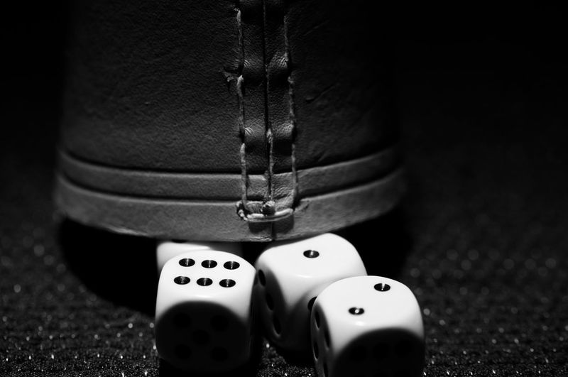 Close-up of dices and leather cup