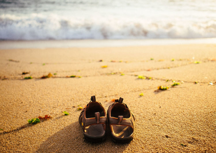 Pair of sandals on sand