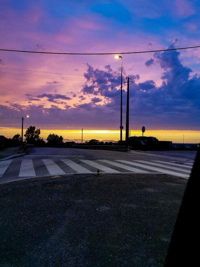 Street against sky during sunset