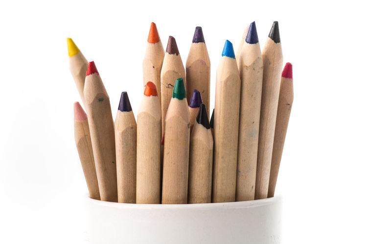Isolated on a white background colorful crayons in a cup. Choice Close-up Colored Pencil Colorful Coloring Crayons Crayons Colorful Variety Choice Art Tools Crayons In A Cup Creative Drawing - Art Product Drawing Pictures  Happy Life No People Painting Tools Pencil Still Life Studio Shot Variation Variety White Background Wood - Material
