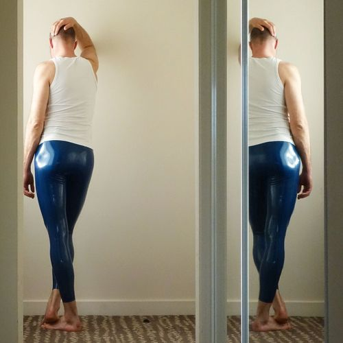 Full length of woman standing at entrance of home
