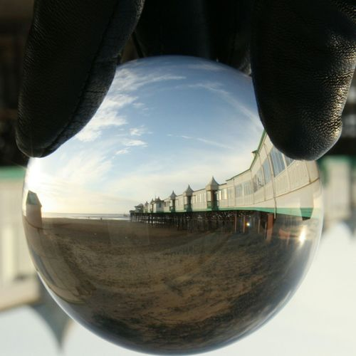 What do you see? Seadide Beavh Pier Sea Sand Dune Beauty In Nature Nature Close Up Glass Ball Lens Ball No People Day Sky Outdoors Close-up